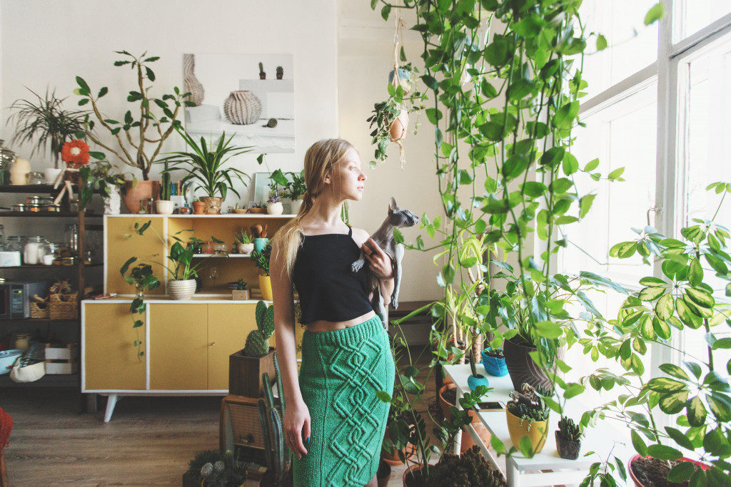 woman with plants in her house